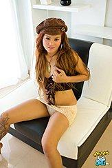 Seated On Chair Long Hair Under Cap Skirt Raised Exposing Her Panties