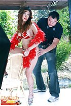 Wearing bikini holding feather boa in high heels photographer posing her