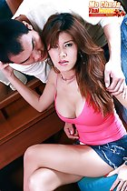 Mo Chada seated with her legs crossed at makeup table long hair big breasts in pink top