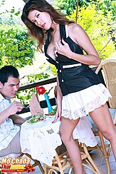 Waitress Mo Chada Standing Beside Table