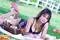 Lying On Her Front Bare Feet Raised Showing Cleavage In Bra