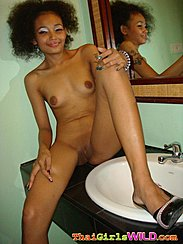 Sitting Beside Wash Basin Small Breasts Legs Open Exposing Her Shaved Pussy