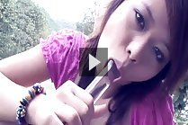Breasty teen Jean Prada playing with big dildo outdoors